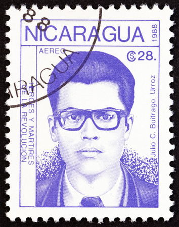 julio: NICARAGUA - CIRCA 1988: A stamp printed in Nicaragua from the Revolutionaries  issue shows Julio C. Buitrago Urroz, circa 1988.
