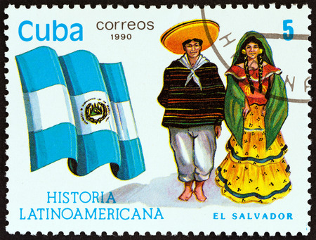 sello: CUBA - CIRCA 1990: A stamp printed in Cuba from the Latin American History 5th series issue shows Flag and Traditional Costumes El Salvador, circa 1990. Editorial