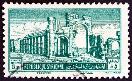 severus: SYRIA - CIRCA 1952: A stamp printed in Syria shows the Monumental Arch, Palmyra, circa 1952.
