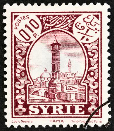 mandate: SYRIA - CIRCA 1930: A stamp printed in Syria shows Hama, circa 1930. Editorial