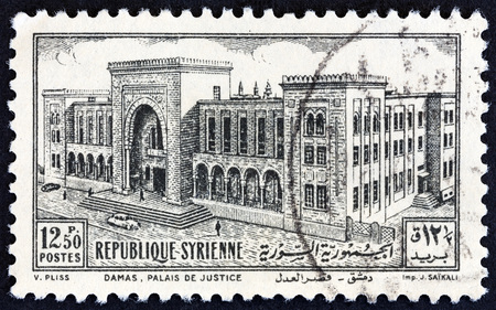 damascus: SYRIA - CIRCA 1952: A stamp printed in Syria shows Palace of Justice, Damascus, circa 1952. Editorial