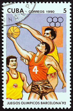 olympic sports: CUBA - CIRCA 1990: A stamp printed in Cuba from the Olympic Games, Barcelona 1992  issue shows Basketball, circa 1990.