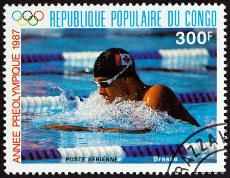 estampilla: CONGO REPUBLIC - CIRCA 1987: A stamp printed in Congo from the Olympic Games - Seoul, South Korea  issue shows Breaststroke, circa 1987. Editorial