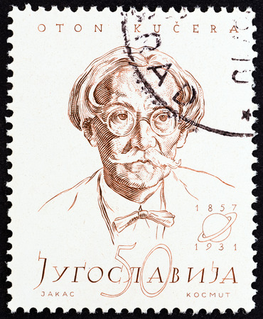 physicist: YUGOSLAVIA - CIRCA 1957: A stamp printed in Yugoslavia from the Personalities  issue shows Oton Kucera (physicist, birth centenary), circa 1957. Editorial