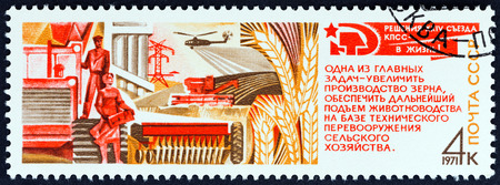 wheatfield: USSR - CIRCA 1971: A stamp printed in USSR from the Resolutions of 24th Communist Party Congress  issue shows farm workers and wheatfield (Agricultural Production), circa 1971.