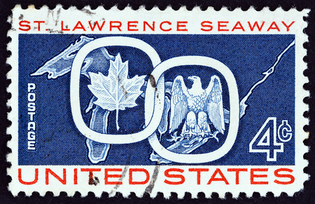 philately: USA - CIRCA 1959: A stamp printed in USA from the issued for the opening of St. Lawrence Seaway shows Maple Leaf linked with American Eagle, circa 1959. Editorial