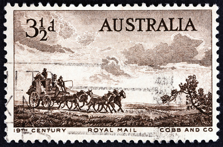 lindsay: AUSTRALIA - CIRCA 1955: A stamp printed in Australia shows Cobb & Co. Coach (from etching by Sir Lionel Lindsay), circa 1955.