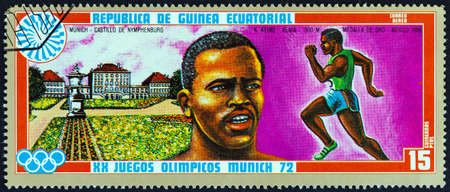 nymphenburg palace: EQUATORIAL GUINEA - CIRCA 1972: A stamp printed in Equatorial Guinea from the Olympic games, Munich issue shows Kipchoge Keino and Nymphenburg Palace, circa 1972.