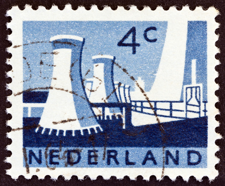 cooling towers: NETHERLANDS - CIRCA 1963: A stamp printed in the Netherlands shows Cooling towers, State mines, Limburg, circa 1963.