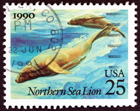 jubatus: USA - CIRCA 1990: A stamp printed in USA from the Marine Mammals  issue shows Northern Sea Lions (Eumetopias jubatus), circa 1990.