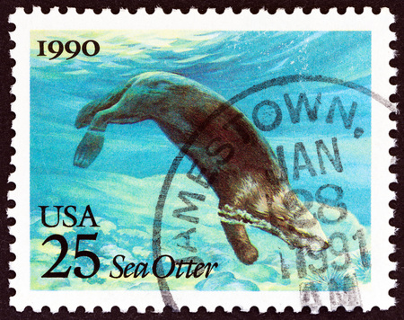 philately: USA - CIRCA 1990: A stamp printed in USA from the Marine Mammals  issue shows Sea Otter (Enhydra lutris), circa 1990.