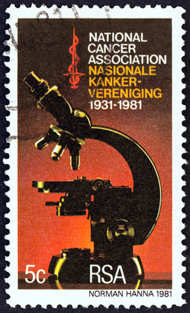 suid: SOUTH AFRICA - CIRCA 1981: A stamp printed in South Africa issued for the 50th anniversary of National Cancer Association shows Microscope, circa 1981.