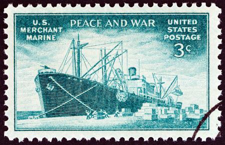 freighter: USA - CIRCA 1946: A stamp printed in USA shows Liberty type freighter unloading cargo, circa 1946.