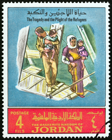 tragedy: JORDAN - CIRCA 1969: A stamp printed in Jordan from the The Tragedy and the Plight of the Refugees  issue shows family looking at destroyed house, circa 1969.