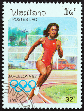 sello: LAOS - CIRCA 1992: A stamp printed in Laos from the Olympic Games, Barcelona  issue shows running, circa 1992. Editorial