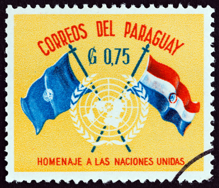 un used: PARAGUAY - CIRCA 1960: A stamp printed in Paraguay from the U.N. Day  issue shows U.N. Emblem and Flags, circa 1960. Editorial