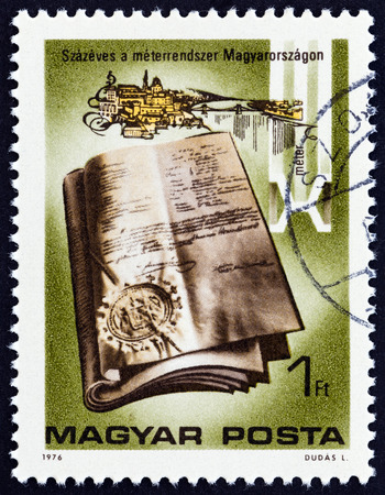 metric: HUNGARY - CIRCA 1976: A stamp printed in Hungary from the Centenary of Introduction of Metric System into Hungary  issue shows Metric System Act, 1876, circa 1976. Editorial
