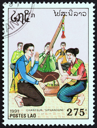 laotian: LAOS - CIRCA 1991: A stamp printed in Laos from the Traditional Music  issue shows Siphandone singer, circa 1991. Editorial