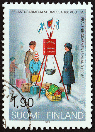 FINLAND - CIRCA 1989: A stamp printed in Finland from the Centenary of Salvation Army in Finland  issue shows Christmas Collection, circa 1989.