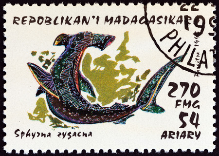 MADAGASCAR - CIRCA 1993: A stamp printed in Madagascar from the Sharks  issue shows Smooth hammerhead (Sphyrna zygaena), circa 1993. Editorial