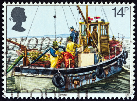 dredging tools: UNITED KINGDOM - CIRCA 1981: A stamp printed in United Kingdom from the 100th anniversary of the Royal National Mission of Fishermen  issue shows Cockle-dredging from Linsey II, circa 1981. Editorial