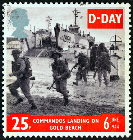 anniversary beach: UNITED KINGDOM - CIRCA 1994: A stamp printed in United Kingdom from the 50th anniversary of D-Day  issue shows commandos landing on gold beach, circa 1994.