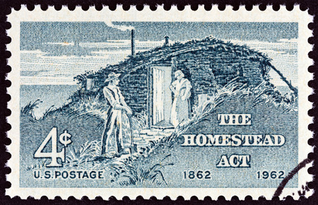 homestead: USA - CIRCA 1962: A stamp printed in USA issued for the centenary of Homestead Act shows Settlers, circa 1962.