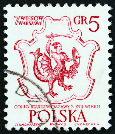 sello: POLAND - CIRCA 1965: A stamp printed in Poland from the 700th anniversary of Warsaw  issue shows 17th century Arms of Warsaw, circa 1965. Editorial