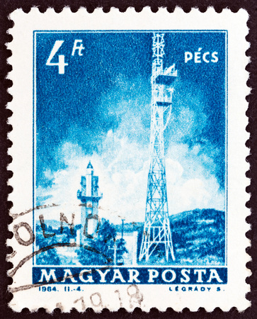 estampilla: HUNGARY - CIRCA 1964: A stamp printed in Hungary from the Transport and Communications issue shows Television Tower, Pecs, circa 1964.