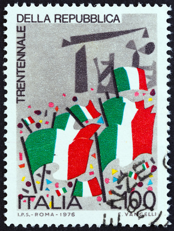 timbre: ITALY - CIRCA 1976: A stamp printed in Italy issued for the 30th anniversary of Republic shows Republican Flags, circa 1976.