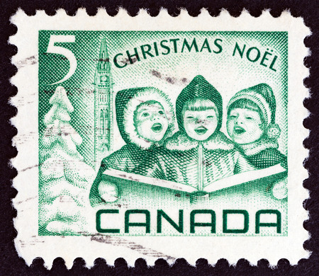 canada stamp: CANADA - CIRCA 1967: A stamp printed in Canada from the Christmas issue shows Carol Singers, circa 1967. Editorial