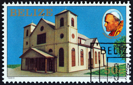 estampilla: BELIZE - CIRCA 1983: A stamp printed in Belize issued for the Visit of Pope John Paul II shows church, circa 1983.