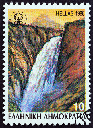 GREECE - CIRCA 1988: A stamp printed in Greece from the Waterfalls issue shows Catarractis village falls at the foot of the Tzoumerka Mountain Range, circa 1988. Editorial