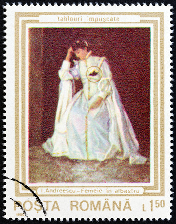 sello: ROMANIA - CIRCA 1990: A stamp printed in Romania from the Paintings damaged during the Uprising issue shows Woman in White (Ion Andreescu), circa 1990.