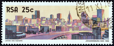 suid: SOUTH AFRICA - CIRCA 1986: A stamp printed in South Africa from the The 100th anniversary of Johannesburg issue shows Johannesburg skyline, 1986, circa 1986.