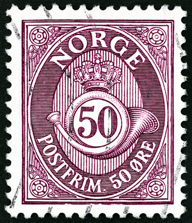 posthorn: NORWAY - CIRCA 1910: A stamp printed in Norway shows crown, post horn and value, circa 1910.