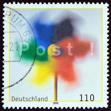 bundespost: GERMANY - CIRCA 2000: A stamp printed in Germany shows Toy Windmill and Post!, circa 2000.