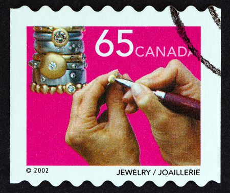 canada stamp: CANADA - CIRCA 2002: A stamp printed in Canada from the Traditional Arts and Crafts issue shows Jewelry, circa 2002. Editorial