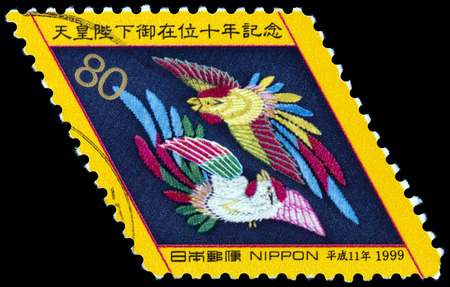 chinese phoenix: JAPAN - CIRCA 1999: A stamp printed in Japan from the 10th Anniversary of Accession of Emperor Akihito issue shows Chinese phoenix embroidery Engiraku costume, circa 1999. Editorial