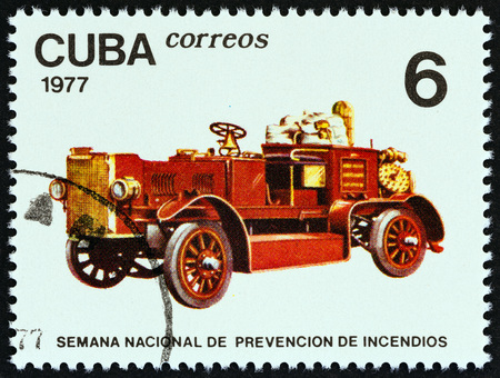 antique fire truck: CUBA - CIRCA 1977: A stamp printed in Cuba from the Fire Prevention Week issue shows Early motor fire pump, circa 1977.