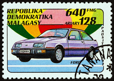 estampilla: MADAGASCAR - CIRCA 1993: A stamp printed in Madagascar from the Automobiles issue shows Ford, circa 1993.