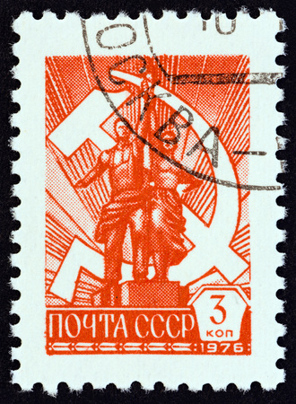 USSR - CIRCA 1976: A stamp printed in USSR shows worker and collective farmer, circa 1976. Editorial