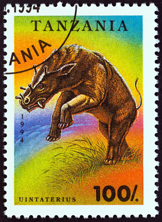 TANZANIA - CIRCA 1994: A stamp printed in Tanzania from the Prehistoric Animals  issue shows Uintatherium, circa 1994.