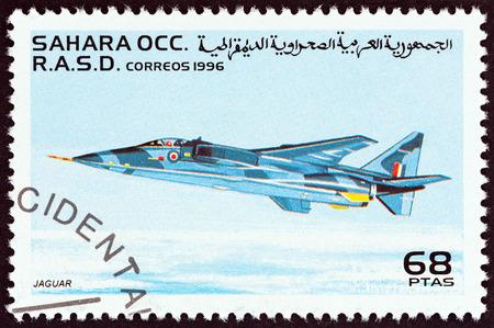 WESTERN SAHARA - CIRCA 1996: A stamp printed in Western Sahara shows SEPECAT Jaguar aircraft, circa 1996.