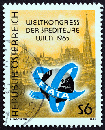 forwarding: AUSTRIA - CIRCA 1985: A stamp printed in Austria issued for the International Association of Forwarding Agents World Congress, Vienna shows emblem and view of Vienna, circa 1985.