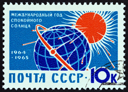 USSR - CIRCA 1964: A stamp printed in USSR from the International Quiet Sun Year issue shows Globe and Sun, circa 1964.