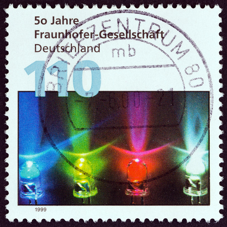 bundespost: GERMANY - CIRCA 1999: A stamp printed in Germany issued for the 50th anniversary of Fraunhofer Society (for applied research) shows coloured diodes, circa 1999.