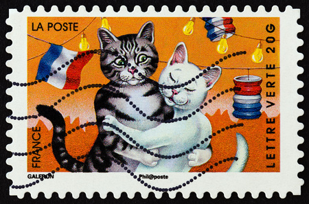 FRANCE - CIRCA 2014: A stamp printed in France from the Holiday issue shows cats, circa 2014. Editorial