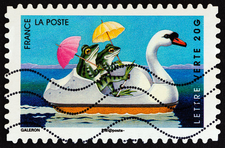 FRANCE - CIRCA 2014: A stamp printed in France from the Holiday issue shows frogs, circa 2014. Editorial