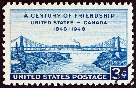 USA - CIRCA 1948: A stamp printed in USA issued for the centenary of friendship between United States and Canada shows Niagara Railway Suspension Bridge (from print by H. Peters), circa 1948.